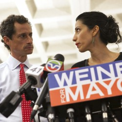 New York mayoral candidate Anthony Weiner and his wife, Huma Abedin, attend a news conference in New York, on July 23, 2013.