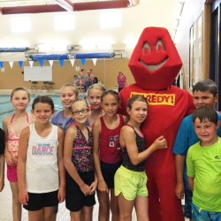 "Getting their picture taken with ""REDY,"" the mascot of the 2016 REDY Youth Triathlon to be held on September 11th at UMPI are (l to r) Cruze Casavant, Charli Casavant, Rhianna Desjardin, Ava Holder, Tayler Thompson, Anna Durost, Olivia Locke, Jayden Harvell, Nolan Holder, and Caleb Holder."