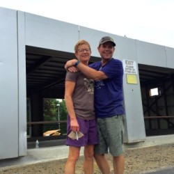 Allison Reid and Bob Johnson embrace outside their soon-to-open toast bar.