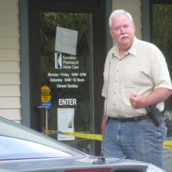 Former Rockport Police Chief Mark Kelley stands outside Kennebec Pharmacy and Home Care after a reported robbery in September 2014.
