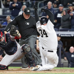 New York Yankees catcher Brian McCann (34) slides home safe as Boston Red Sox catcher Ryan Hanigan (10) misses the ball during the eighth inning at Yankee Stadium. New York Yankees won 5-1.