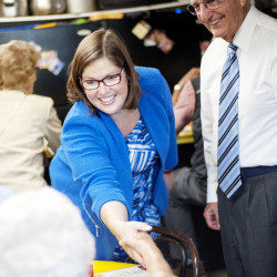 Democratic 2nd Congressional District candidate Emily Cain (left) and former Sen. George Mitchell greet patrons before grabbing lunch on Sept. 22 at Simones' Hot Dog Stand in Lewiston.