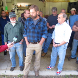 Dan Harrington (center), a worm digger from Woolwich, speaks recently at a local bait shop in favor of a bill submitted by U.S. Rep. Bruce Poliquin (right) that would allow marine harvesters to access the intertidal zone at Acadia National Park and would give retroactive congressional approval to a 1,400-acre expansion of the park last year on the Schoodic Peninsula.