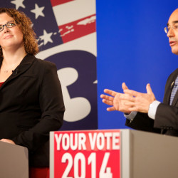 Emily Cain (left) listens as Bruce Poliquin makes a comment about her during the 2nd Congressional District debate on Tuesday at the CBS 13 television studios in Portland on Oct. 14, 2014.