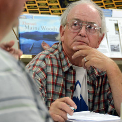 The president of the Patten Lumbermen's Museum board of directors, Frank Rogers, listens during a meeting at the museum on Thursday night.