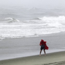A man walks along the surf as Tropical Storm Hermine passes through Garden City Beach, South Carolina, on Friday.