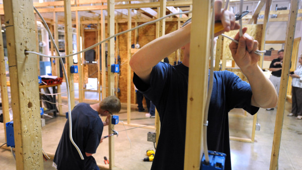 Residents of the former Mountain View Youth Development Center practice wiring a building at the United Technologies Center in Bangor in 2011.