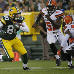 Green Bay Packers tight end Justin Perillo (left) runs for 18 yards on a reception during the first quarter of their game against the Cleveland Browns on Aug. 12 at Lambeau Field.
