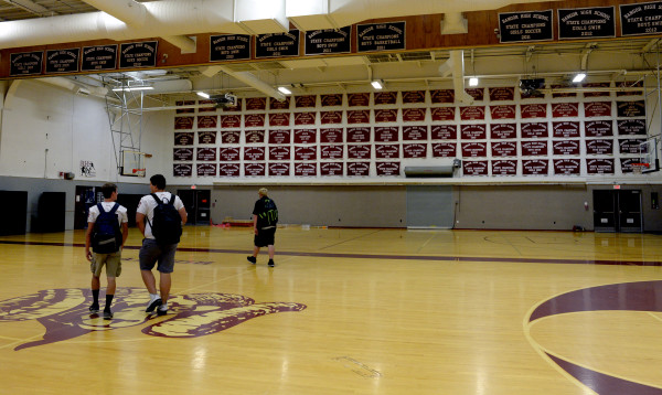 A hundred championship banners, 99 state titles and one New England crown, can be seen hanging on Sept. 2 in the school's Red Barry Gym at Bangor High School.