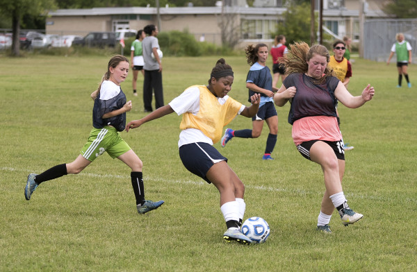 Bangor High School girls soccer players compete during the first team practice of the season on Aug. 15 in Bangor.