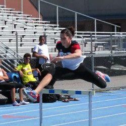 Jesse Labreck, a former University of Maine track and field heptathlete, clears a hurdle in May 2013 at UMaine.
