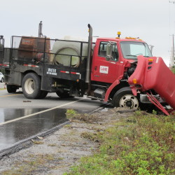 A Lane Construction truck blocks Route 3 on Tuesday afternoon after it was involved in a fatal crash near Ellsworth Chainsaw. The truck collided head-on with Pontiac sport-utility vehicle around 8:40 a.m., killing two women in the SUV, according to the Hancock County Sheriff's Department. Route 3 was closed for several hours with traffic re-routed on Routes 230 and 204.