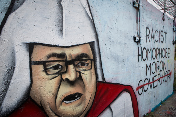A spray-painted portrait of Maine Gov. Paul LePage dressed in a Ku Klux Klan costume in Portland on Tuesday is a accompanied by text labeling him and a &quotdump LePage&quot message further down the wall. The graffiti appeared sometime last week.