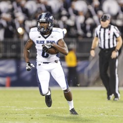 University of Maine wide receiver Jaleel Reed heads up the field after making a catch against the University of Connecticut during Thursday night's game in East Hartford, Connecticut.