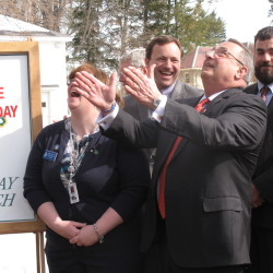 Gov. Paul LePage (second from right) marvels at the size of the large maple tree on the grounds of the governor's mansion in Augusta, March 10, 2010.