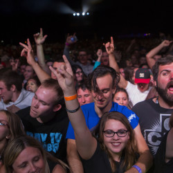 Fans dance and sing along while A Day To Remember plays during their show at Darling's Waterfront Pavilion in Bangor.