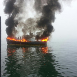 Coast Guard responders work Thursday to extinguish a fire that destroyed the lobster boat Bigger Dirls in Jonesport.