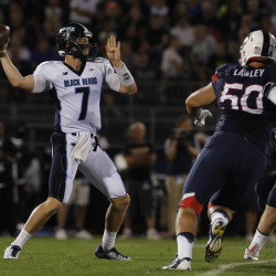 University of Maine quarterback Dan Collins (left) throws a pass against the University of Connecticut Huskies in the second quarter of their football game on Sept. 1 at Rentschler Field in East Hartford, Connecticut.