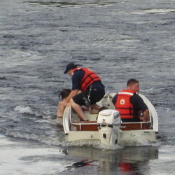 Brunswick firefighters rescued two unidentified swimmers from the Androscoggin River Friday afternoon.