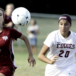 Mariah Vaillancourt, right, of Edward Little High School and Meg Putnam of Bangor High chase down the ball during the first half in Auburn on Friday.