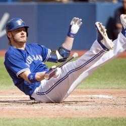 Toronto Blue Jays third baseman Josh Donaldson (20) falls to the ground after almost being hit with a pitch during the fifth inning of Saturday's game against the Boston Red Sox at Rogers Centre. The Toronto Blue Jays won 3-2.