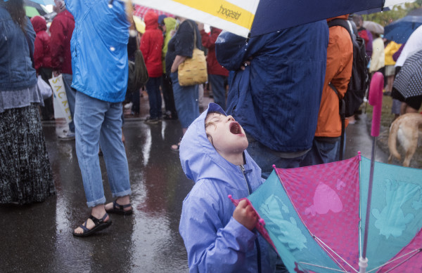 Harriet Henkel, 5, of Somesville catches some rain drops during a Sunday event in Bangor showing solidarity with the Standing Rock Sioux Tribe in North Dakota protesting a pipeline construction. Members of Maine Indian tribes and others held the event at the Bangor Waterfront Sunday.