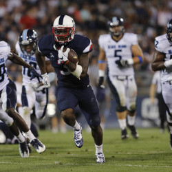 University of Connecticut Huskies running back Ron Johnson (center) runs the ball for a touchdown against the University of Maine Black Bears in the second half of their football game on Sep. 1 at Rentschler Field in East Hartford, Connecticut.