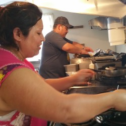 Teresa Jungo (left) and Peter Valencia work recently at Down East Mexican Takeout in Gouldsboro.