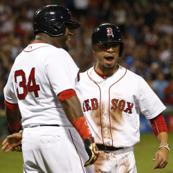 Boston Red Sox designated hitter David Ortiz (left) and right fielder Mookie Betts celebrate after scoring during the first inning against the Baltimore Orioles Monday night at Fenway Park in Boston.