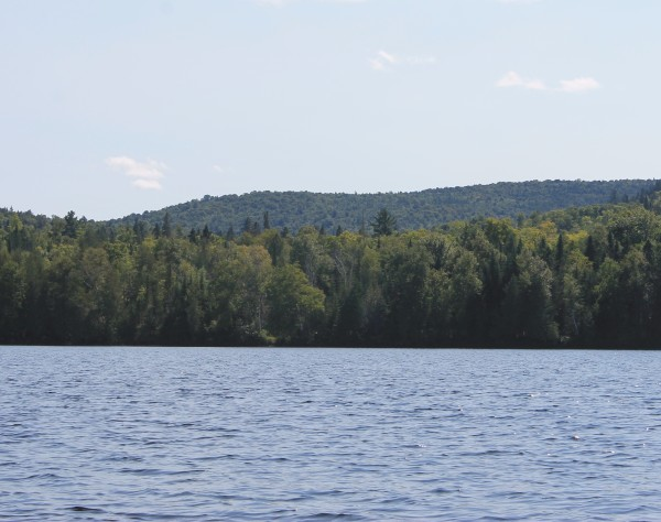 Bald Mountain seen from nearby Carr Pond, in the North Maine Woods 10 miles west of Portage. Earning its name when it was logged in the 1970s, the 1,526-foot mountain holds deposits of copper, gold, silver and other minerals that could be extracted through an open-pit mine.
