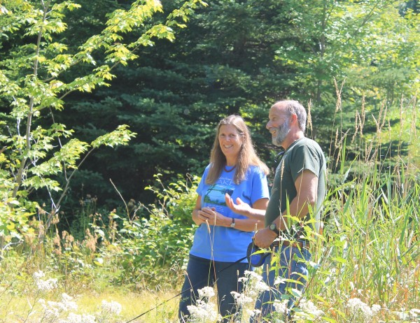 Betsy and Craig Terrell at the base of Bald Mountain, the site of a potential open pit mine about 2 miles from the camp on Carr Pond that has been in Betsy's family for more than half a century.