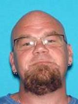 Police are looking for Christopher Julian, 43, and his black Mercury Mountaineer, plate number 1874MD.