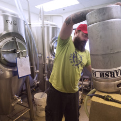 Clay Randall head brewer at Marsh Island Brewing prepares kegs to be filled with beer Tuesday. The Orono brewery is opening a tasting room late next week.