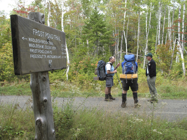 Baxter State Park Director Jensen Bissell, seen here talking with hikers in 2009, has concerns that his new neighbor, the Katahdin Woods and Waters National Monument, will cause problems for his park.