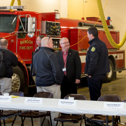 Federal and local law enforcement chat after a round-table discussion about terrorist attacks in Bangor in this February 2016 file photo.