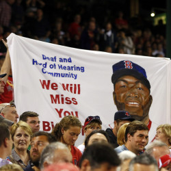 Fans hold up a sign for Boston Red Sox designated hitter David Ortiz during the game between the Boston Red Sox and the Baltimore Orioles Tuesday  night at Fenway Park in Boston.