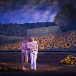 "Julie Arnold Lisnet as Annie (left) and Sharon Zolper as Chris admire the sunflowers that blossom at the end of ""Calendar Girls"" at the Bangor Opera House."
