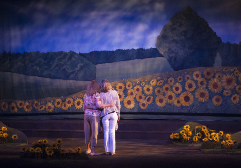 Julie Arnold Lisnet as Annie (left) and Sharon Zolper as Chris admire the sunflowers that blossom at the end of &quotCalendar Girls&quot at the Bangor Opera House.