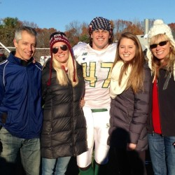 Ellis Throckmorton (middle) and his sister Hillary Throckmorton (second right) pose with their mother, Emily Ellis (far right), father, Tim Throckmorton (left), and stepmother, Emilie Brand Throckmorton, after a Husson football game in 2015. The Throckmorton children have been successful athletes after growing up with celebrity parents.