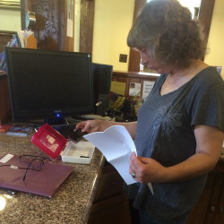 Librarian Heidi Hinckley shows off a Wi-Fi checkout device at the Peabody Memorial Library in Jonesport.