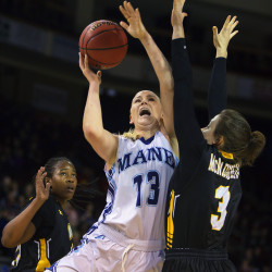 Mikaela Gustafsson (center) drives hard for two past Maryland Baltimore County's Liz McNaughton (right) and Pandora Wilson in a January 2016 game at the Cross Insurance Center in Bangor. Maine won 65-55.