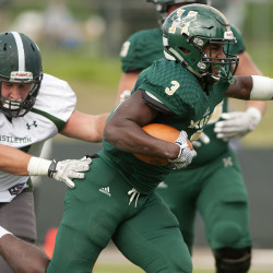 Husson's John Smith (right) runs past Castleton during their football game at Husson in Bangor in this October 2015 file photo.
