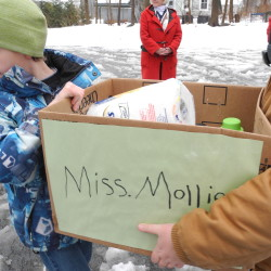 Children from Captain Albert Stevens Elementary School bring boxes of soap and other hygiene products Thursday to the storage area for the Soap Closet, a group that is working to help low-income folks have access to items they need to care for themselves, in this March 2013 file photo.