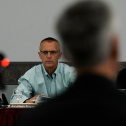 Board of Environmental Protection members Alvin Ahlers (left), Jonathan Mapes (center) and Mary Sauer listen to the testimonies of Jeff Crawford and Mark Stebbins of the Maine Department of Environmental Protection during a public hearing on the third round of DEP mining regulations on Thursday at the Augusta Civic Center.