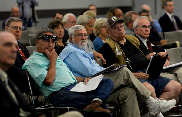 Attendees listen to people testify before the Board of Environmental Protection during a public hearing on the third round of Department of Environmental Protection mining regulations on Thursday at the Augusta Civic Center.