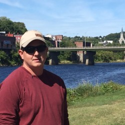 "Sean Scanlon of Dresden Mills ran to the river bank, jumped in the water, grabbed the unresponsive child and swam back to shore, according to police. ""The little boy is still fighting for his life,"" Scanlon said Saturday. ""I never saw him until I jumped in after him. I'm just a father."""