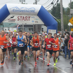 Runners take off at the start of the Caribou Marathon on Sunday.