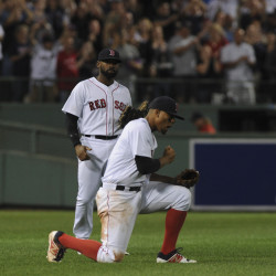Boston Red Sox shortstop Xander Bogaerts (front) reacts after center fielder Jackie Bradley Jr. makes a catch for the final out during the ninth inning against the New York Yankees at Fenway Park in Boston Sunday night.