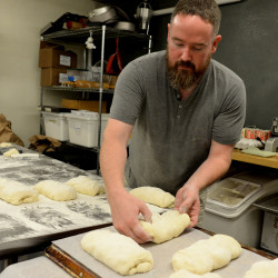 Lee-Russel Dunn is the baker at Fork & Spoon in Bangor. He makes all of the pastries and breads fresh each morning. Dunn makes loaves of ciabatta bread Friday morning.