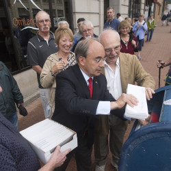 U.S. Rep. Bruce Poliquin (center) mails letters in Bangor Monday to more than 200 U.S. House members urging them to join him and other lawmakers in repealing provisions of the Social Security program that negatively affect some public servants, such as the ones participating in a rally in Bangor on Monday.